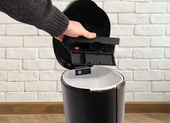 Emptying a trap into a garbage pail