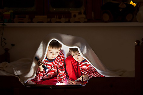 kids with flashlights during a winter storm